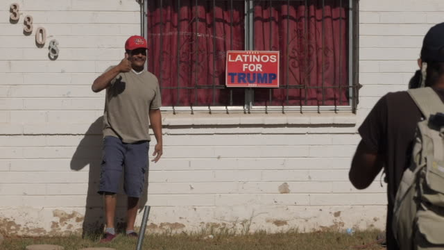 exterior shots of people campaigning at an event encouraging people to get out and vote ahead of the us election, campaigners marching through the... - latin american and hispanic ethnicity stock videos & royalty-free footage
