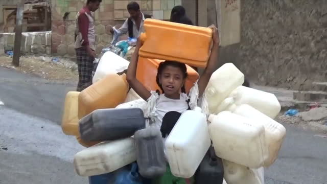 Exterior shots of people carrying water in jerry cans on December 13 2016 in Sana'a Yemen