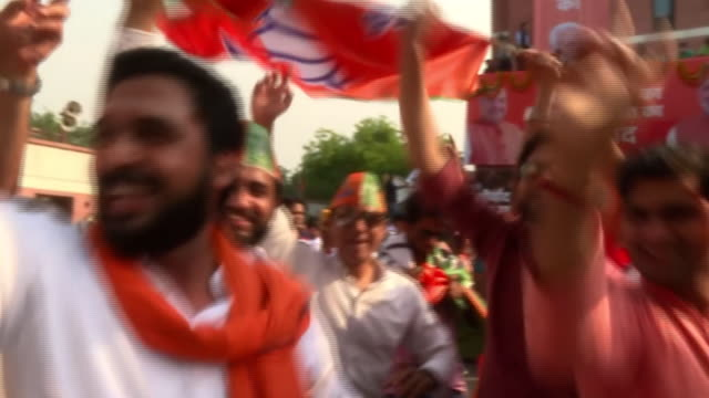 exterior shots of people celebrating after india's prime minister narendra modi secures another five years in office on may 23 2019 in mumbai india - staatsdienst stock-videos und b-roll-filmmaterial