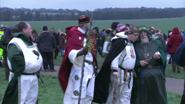 exterior shots of people celebrating the winter solstice at stonehenge including druids blessing people>> on december 22 2015 in amesbury united... - paganism stock videos and b-roll footage