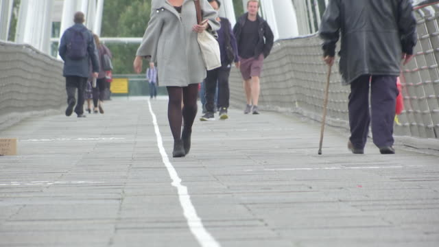 exterior shots of people crossing hungerford bridge and golden jubilee bridges, on the 28th august 2020 in london, england - hungerford bridge stock videos & royalty-free footage