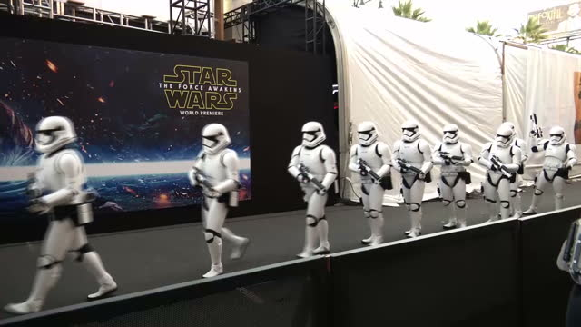 exterior shots of people dressed as stormtroopers walk in long line across red carpet at the premiere of star wars the force awakens on december 14... - star wars stock videos & royalty-free footage