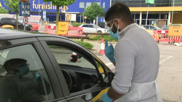 exterior shots of people driving through a drive-through coronavirus testing centre at wembley stadium on 29 april 2020 in london, united kingdom - exam stock videos & royalty-free footage