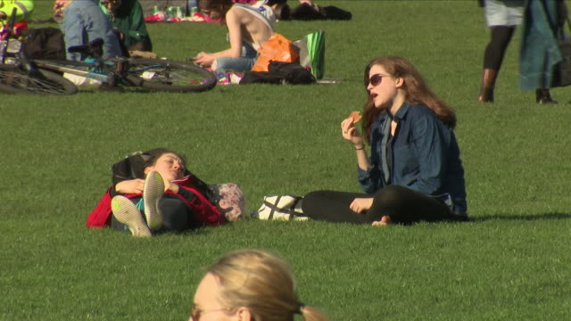 exterior shots of people enjoying a sunny day in the meadows public park on 19 april 2018 in edinburgh scotland - sunny stock videos & royalty-free footage