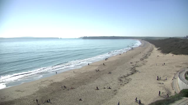 exterior shots of people enjoyng a day on the beach on 26th february 2019 in tenby wales - sun stock videos & royalty-free footage