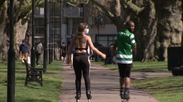 exterior shots of people exercising and sunbathing in london fields park in hackney during the coronavirus lockdown on 5 april 2020 in london united... - natural parkland stock videos & royalty-free footage