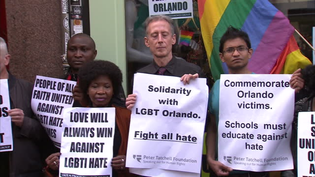 exterior shots of people gathered at soho vigil for orlando nightclub shootings victims including peter tatchell and leader of the green party... - green party stock videos and b-roll footage