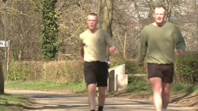 exterior shots of people going for walks or jogging in a park during the coronavirus epidemic and lockdown on 25th march 2020 york united kingdom - jogging stock videos & royalty-free footage