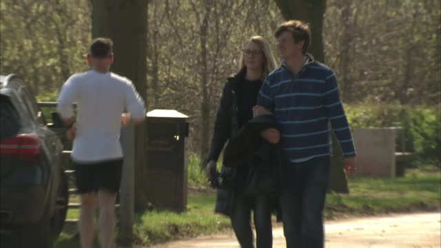 exterior shots of people going for walks or jogging in a park during the coronavirus epidemic and lockdown on 25th march 2020 york, united kingdom. - public park stock videos & royalty-free footage