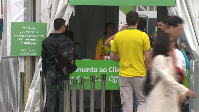 exterior shots of people going through the security marquee at the olympic village rio2016 signs and flags posters for different sports on the... - 記号点の映像素材/bロール