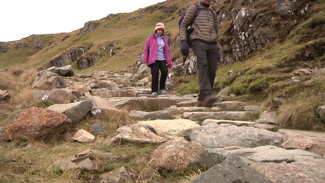 exterior shots of people hiking in snowdonia on december 02 2016 in wales united kingdom - snowdonia stock videos & royalty-free footage