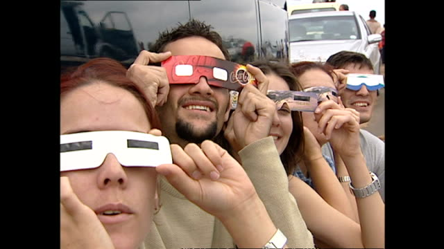 Exterior shots of people in Kruger National Park watching an eclipse through special viewers on December 04 2002 in Krugersdorp South Africa