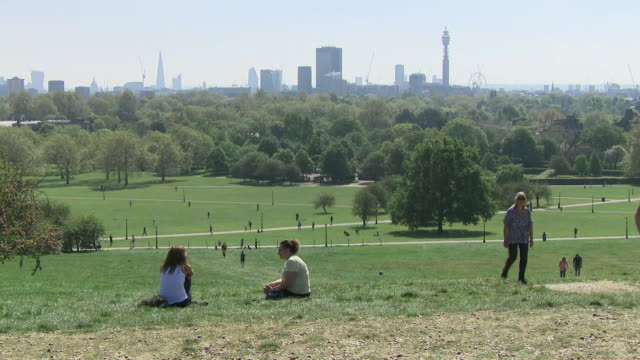 exterior shots of people in the park during coronavirus lockdown on 26 april 2020 in london, united kingdom. - public park stock videos & royalty-free footage