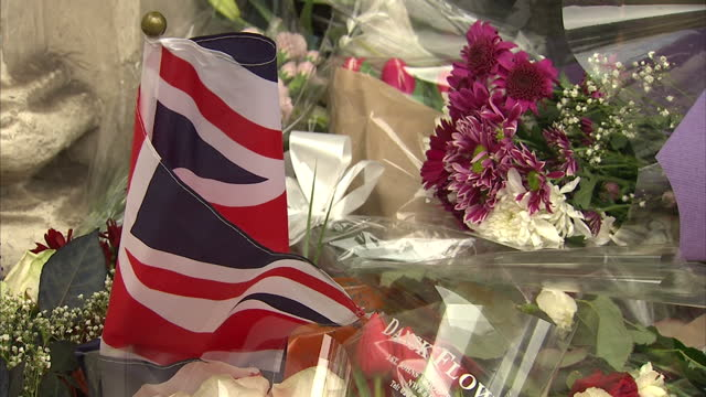 Exterior shots of people leaving flowers and notes of sympathy on the steps of the French Consulate in South Kensington in the wake of Friday's Paris...