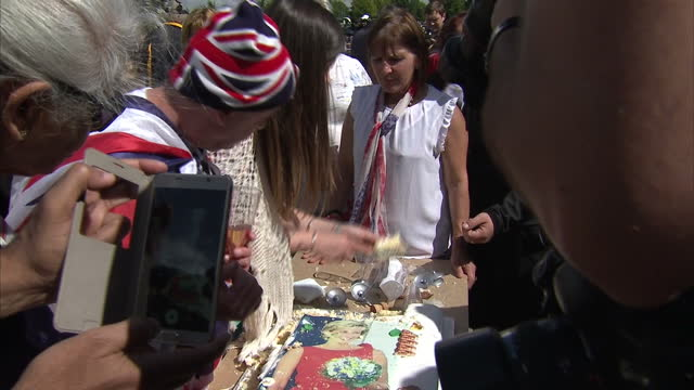 exterior shots of people outside kensington palace cutting a cake with a picture of princess diana on top to mark the anniversary of her death on... - 20th anniversary stock videos & royalty-free footage