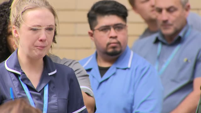 vidéos et rushes de exterior shots of people outside st mary's hospital paying respects to melujean ballesteros a staff nurse at st mary's hospital who died after... - funérailles