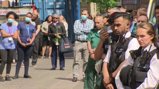 exterior shots of people outside st mary's hospital paying respects to melujean ballesteros a staff nurse at st mary's hospital who died after... - contracting stock videos & royalty-free footage