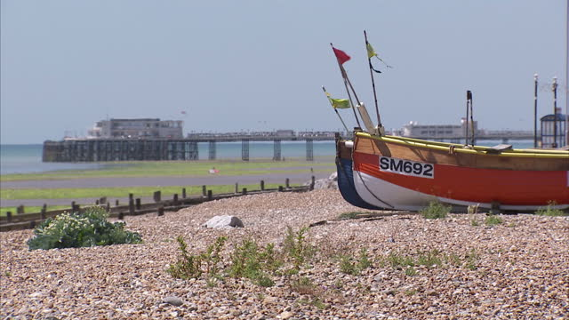 exterior shots of people paddling and walking on worthing beach in the sunshine on 10 july 2015 in worthing, united kingdom - worthing点の映像素材/bロール