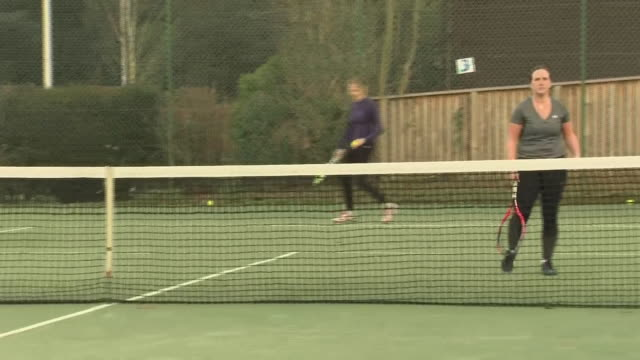 exterior shots of people playing amateur tennis on an artificial pitch on 11 january 2019 in dunblane scotland - ダンブレーン点の映像素材/bロール