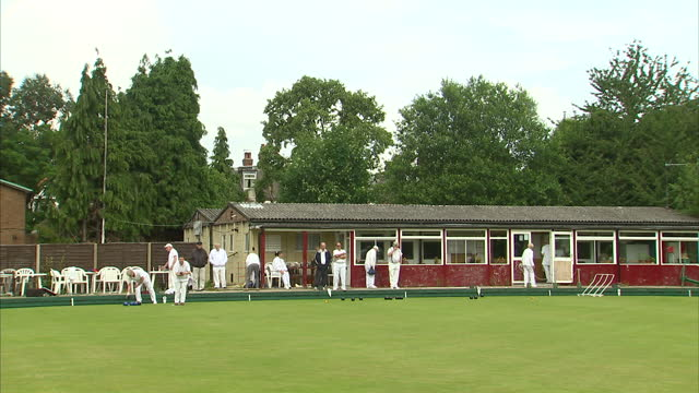 exterior shots of people playing bowls at springfield action bowls club in ealing springfield action bowls club in ealing at springfield action bowls... - ealing stock videos and b-roll footage