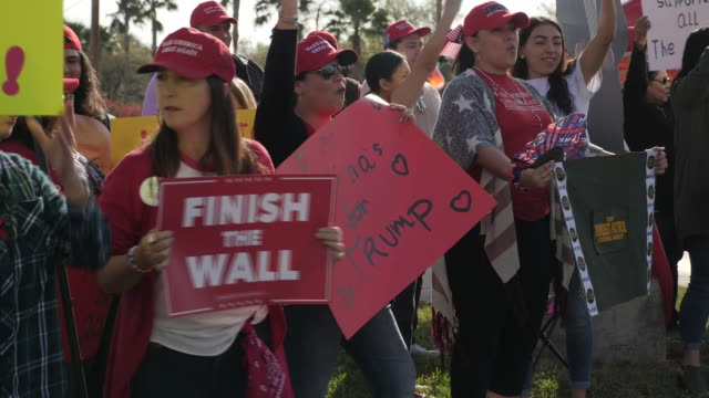 exterior shots of people rallying in support for trump building a wall between the us and mexico on 10 january 2019 in texas united states - surrounding wall stock videos & royalty-free footage