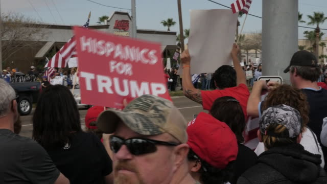 exterior shots of people rallying in support for trump building a wall between the us and mexico and protesters on the other side of the street on 10... - mcallen texas stock videos & royalty-free footage