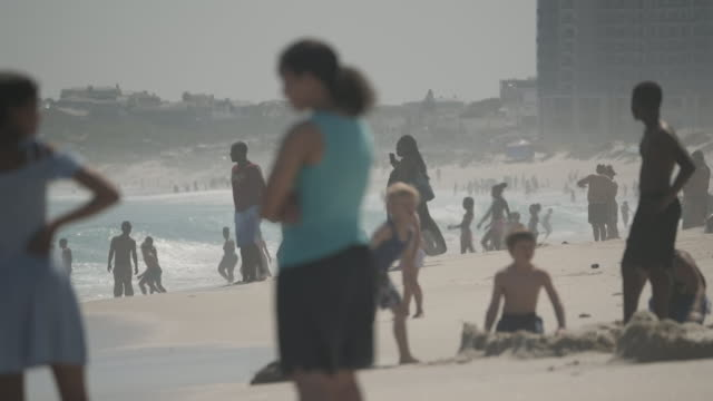 exterior shots of people relaxing and playing on cape town beach in sunshine on 24 september 2019 in cape town, south africa - cape town stock videos & royalty-free footage
