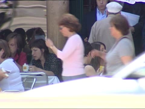 exterior shots of people sat at outdoor cafe tables eating drinking and socialising as cars pass in lisbon city centre on may 11 2007 in lisbon... - cafe culture stock videos and b-roll footage