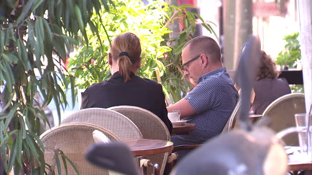 exterior shots of people sat outside cafe in tel aviv eating and drinking cafe culture in tel aviv on september 11 2013 in tel aviv israel - cafe culture stock videos and b-roll footage