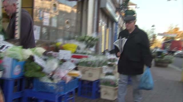 Exterior shots of people shopping at a small business selling vegetables Christmas trees and mistletoe in Claygate>> on December 06 2014 in Claygate...
