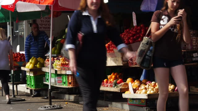 exterior shots of people shopping at a streetfront greengrocer stall in ashkelon on march 17 2015 in ashkelon israel - ashkelon stock videos and b-roll footage