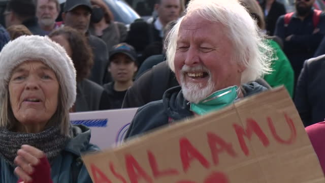 exterior shots of people singing and holding peace placards outside christchurch high court after the sentencing of brenton tarrant on 27 august 2020... - sentencing stock videos & royalty-free footage