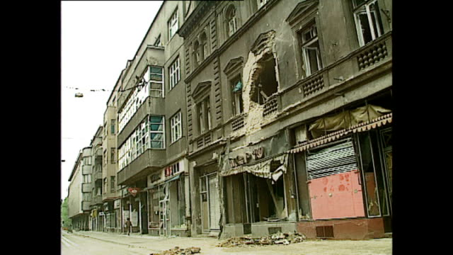 exterior shots of people sitting in cafes and shots of buildings destroyed from fighting in july 1992 in sarajevo, bosnia and herzegovina. - bosnian war stock videos & royalty-free footage
