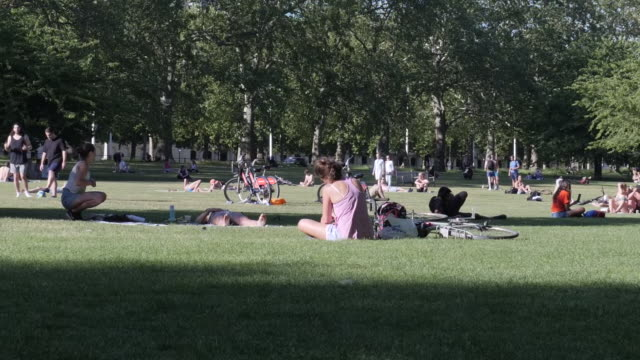 exterior shots of people sunbathing and exercising in st james's park on 20th may 2020 london united kingdom - sunbathing stock videos & royalty-free footage