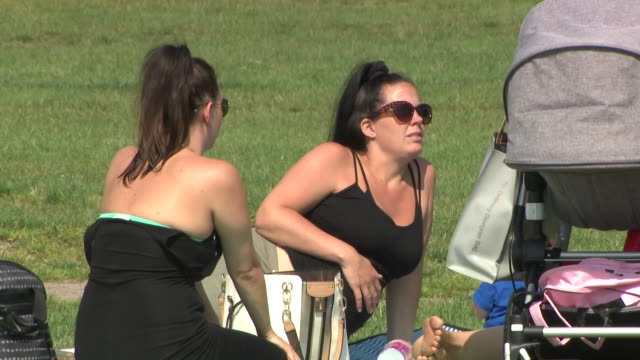 exterior shots of people sunbathing in the park on the hottest day of the year on 24 june 2020 in paignton, united kingdom - sunlight stock videos & royalty-free footage