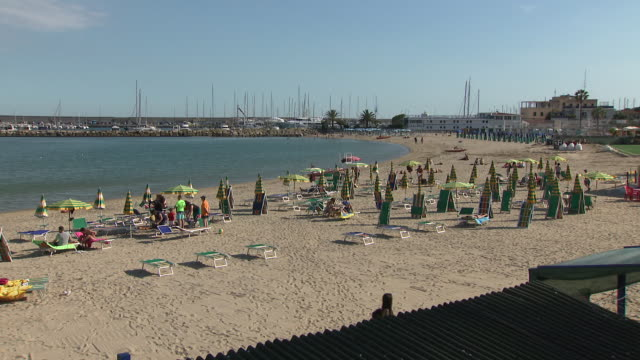 exterior shots of people sunbathing on a beach on 5 june 2019 in sanremo italy - liguria stock videos & royalty-free footage