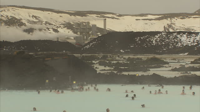Exterior shots of people swimming in the Blue Lagoon geothermal spa pools>> on December 10 2015 in Grindavik Iceland