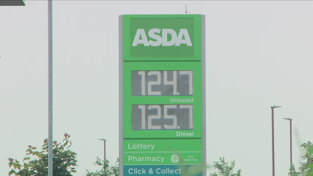 exterior shots of people using fuel pumps at asda petrol station and refuelling vehicles including close up shots of fuel prices displayed on an... - consumerism stock videos & royalty-free footage