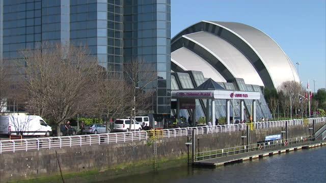 Exterior shots of people walking along the waterfront of the River Clyde enjoying the sunshine and the SEC Armadillo on March 27 2017 in Glasgow...