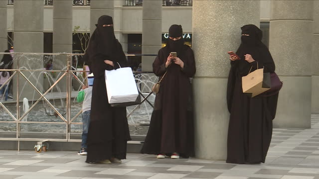 exterior shots of people walking in an outdoor shopping area past a branch of starbucks and fountains on 12 february 2018 in riyadh, saudi arabia - riyadh stock videos & royalty-free footage