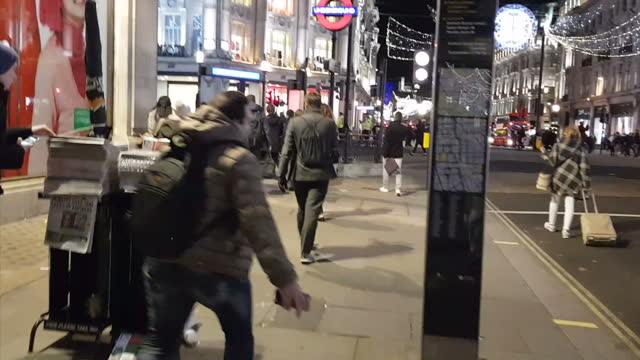 Exterior shots of people walking into Oxford Circus underground station as police reopened it after false reports of a terror attack on 25 November...