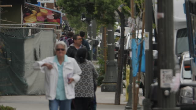 exterior shots of people walking on pavement in a latino neighbourhood on 3 april 2019 in los angeles, united states - latin american and hispanic stock videos & royalty-free footage