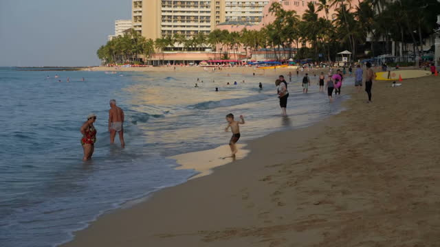 exterior shots of people walking on waikiki beach and surfboards laid out on the beach on 5 november 2017 in waikiki hawaii - honolulu stock videos and b-roll footage