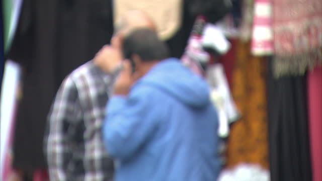 Exterior shots of people walking through Poplar on a busy market day including many members of the Asian and Muslim communities>> on August 20 2014...