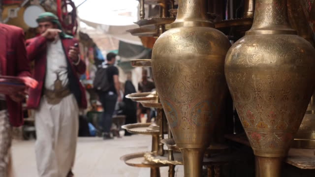 exterior shots of people walking through sana'a old city market and various things for sale on the 17th september 2020 in sana'a, yemen - orthographic symbol stock videos & royalty-free footage