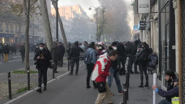 FRA: Tear gas, fires as thousands protest in Paris against police violence, security bill