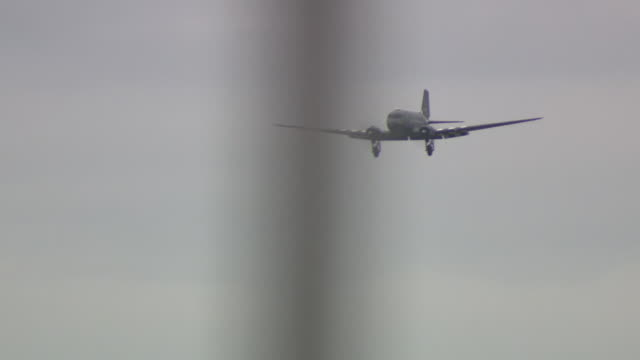 exterior shots of people watching douglas dakota aircraft flying at imperial war museum duxford as part of the d-day 75 anniversary commemorations on... - war stock-videos und b-roll-filmmaterial