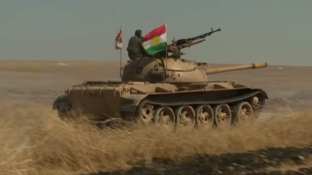 exterior shots of peshmerga iraqi military personnel driving down road on apcs during checks to clear mines ieds planted by isis near batella on... - isis stock videos and b-roll footage