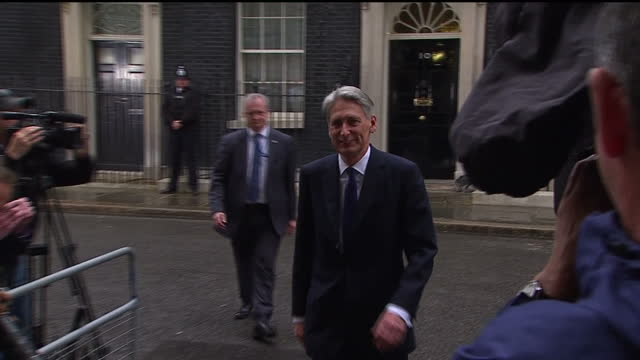 Exterior shots of Philip Hammond MP Foreign Secretary walking from Number 10 Downgin Street towards the Foreign Office on May 08 2015 in London...