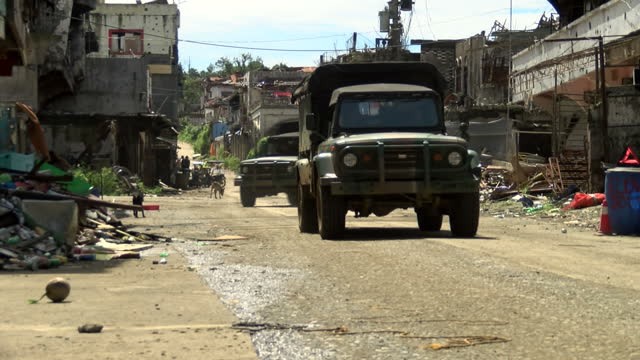 exterior shots of philippine military vehicles and soldiers on the streets of marawi including shots of a soldier with rosary beads tied to his... - rosary beads stock videos & royalty-free footage